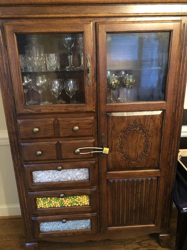 Solid wood kitchen cabinet with four drawers and multiple shelves