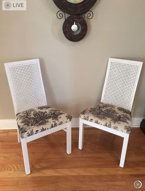 """Two cane back wooden chairs. Sturdy, real wood. 38"""" high. Freshly painted. French motif cream & Black fabric seats. Condition: Like new for Sale in LA, US"""