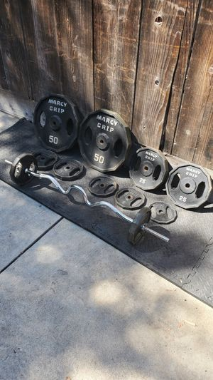 "Beautiful set of marcy grip standard 1""hole weights 200 pounds with a curl bar take all for $400 firm..! for Sale in Modesto, CA"