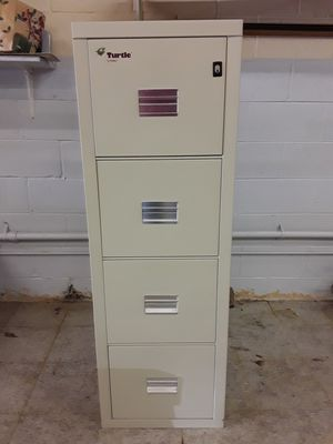 File cabinet fire-king Turtle 4 drawer fire resistant, parchment color, 1 hour rated Fireproof. for Sale in Palos Heights, IL
