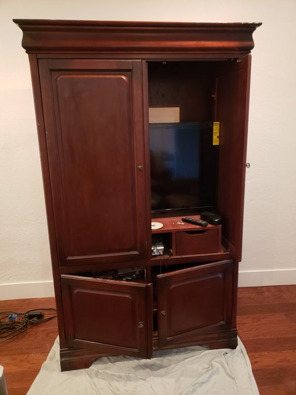 Real oak wood entertainment center and two side cabinets 1yr old great condition