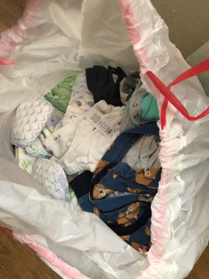 a bag full of newborn baby boy clothes & size 2 diapers for Sale in San Antonio, TX
