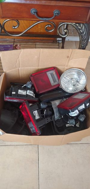 Box of Jeep Tail Lights, Handles, Headlights and Other Parts for Sale in Santa Ana, CA
