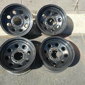 15x7 black steel wheels. 5 on 5.5 lugs, Dodge, Ford, Jeep, more for Sale in Pico Rivera, CA