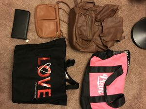 2 pink purses, 3 non brand for Sale in Bakersfield, CA