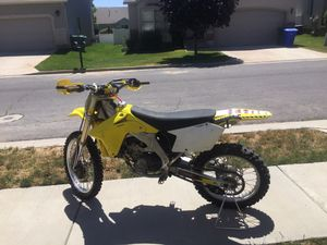 2006 Suzuki RMZ 450 new motor, only Suzuki fluids, one owner, maxxis tires, pro taper accessories, original book on bike, extra new sprockets, new Ev for Sale in Eagle Mountain, UT