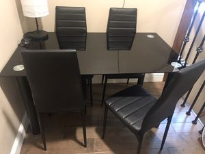 Black glass table and four chairs for Sale in Vallejo, CA