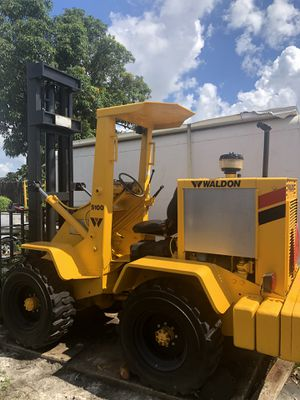 Forklift. 1989 Waldon 5100 Forklift. Compact articulating 4 wheel drive. Runs perfectly fine. Tires are new 4x4. Goes 14' high holds 4,000 lbs. Made for Sale in Miami Gardens, FL