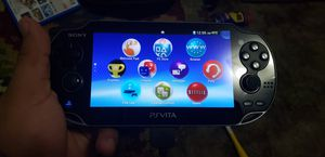 PS VITA PCH-1001 INCLUDES 32GB and 4GB MEMORY CARDS AND GAMES for Sale in Modesto, CA
