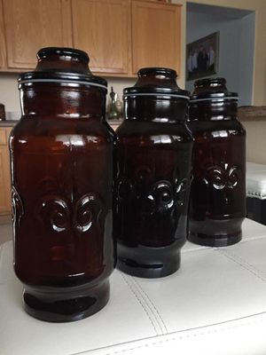 "Vintage amber glass canisters with lids 10""tall for Sale in Surprise, AZ"