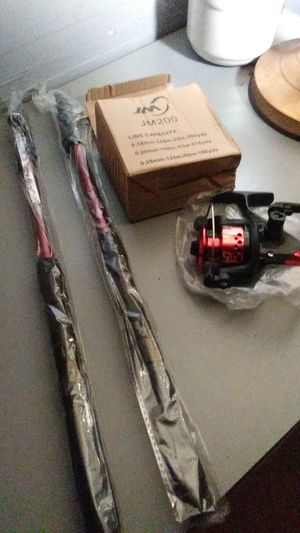 2 extendable fishing rods and 1 reel for Sale in Clearwater, FL