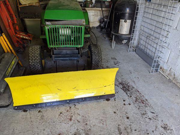 John Deere 240 and snow plow