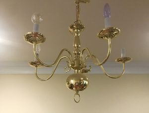 Brass finish chandelier. It's perfectly fine, but it's hanging down from ceiling for painting. for Sale in Newtown, PA