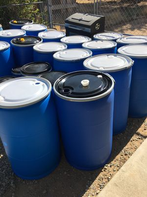 Barrels/Drums/ 55 Gallons Plastic Open Top w/sealed lids & rings for Sale in Victorville, CA