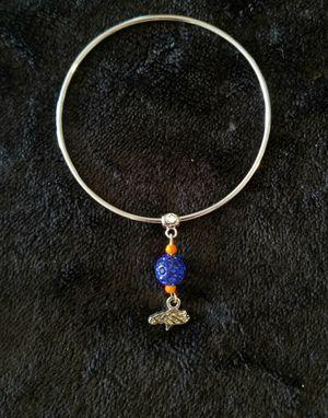Denver Bronco bangle bracelet with charm for Sale in Aurora, CO