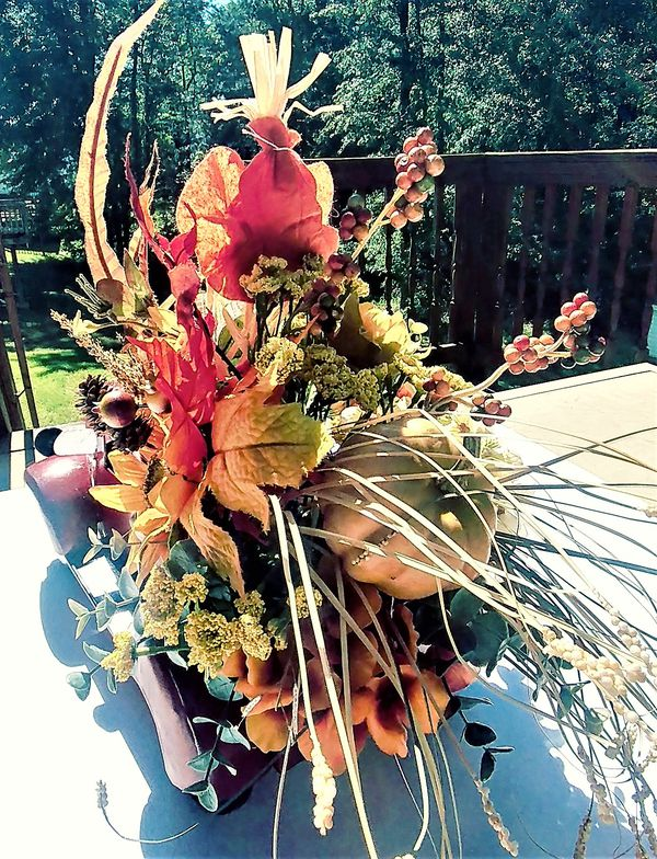 Red farm truck faux flower arrangement
