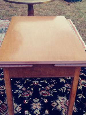 Iron top table with wooden legs and adjustable sides for Sale in Richmond, VA