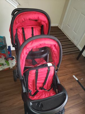 Red and black double stroller for Sale in Nashville, TN