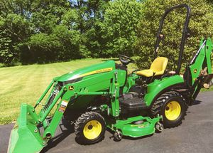 John Deere 1023E Tractor Loader Backhoe. 54D Mid Mower for Sale in Detroit, MI