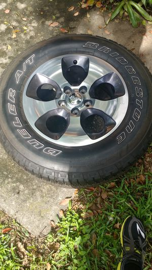 "Jeep TJ JL 5x5 18"" Sahara OEM wheels (set of 5, one with new tire) for Sale in Orlando, FL"