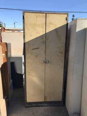 Two doors storage cabinet with 4 shelves $75 for Sale in Downey, CA