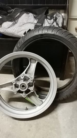BMW motorcycle rim a motorcycle tire size of tire in picture trying to clear space make offer thanks for Sale in Tacoma, WA