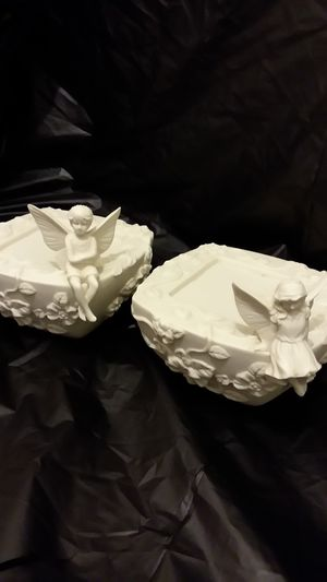 Ceramic boy and girl Angel candle holders / plant stand for Sale in Marysville, WA