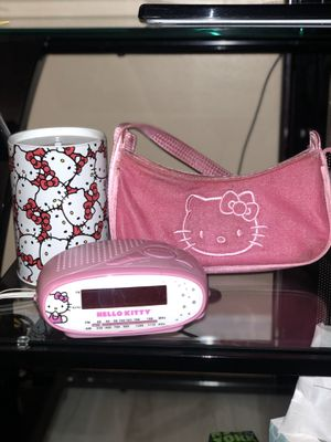 Hello Kitty fans!!! Cute set of 3! Working alarm plug-in alarm clock, mini purse and piggy bank! for Sale in Hawthorne, CA