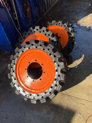 """Solid tires for (bobcat or,,) skid steer, 9"""" axle, 33"""" tall for Sale in Westminster, CA"""