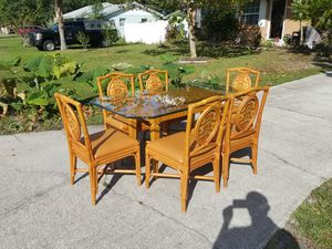 Rattan glass top table with 6 Chairs 38 by 64 for Sale in St. Cloud, FL