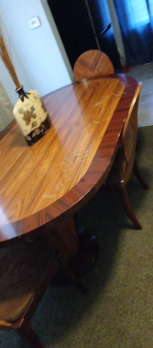 A wooden used table with three chairs for Sale in Lincoln Park, MI