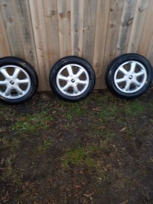 "(3) 175/65/15 BRIDGESTONE TIRES and 15"" MINI COOPER RIMS for Sale in Norfolk, VA"