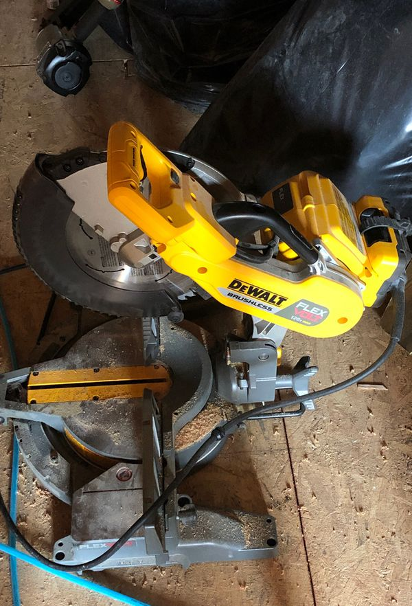 "Dewalt flexvolt mitre saw 12"" used once. Comes with adapter only no batteries"