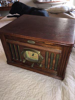 Brosley radio am fm, cassette player, raising lid 33/78 Medium oak colored wood. for Sale in Hartsburg, MO