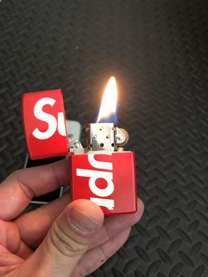 Supreme u.a zippo lighter red or black brand new for Sale in Irvine, CA