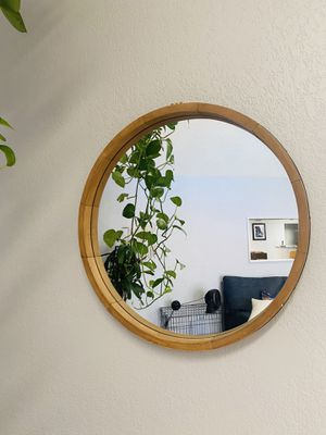 Round wood mirror with black detailing for Sale in Tempe, AZ