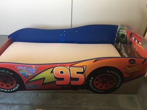 Cars bed with mattress desk and book shelf for Sale in Hesperia, CA