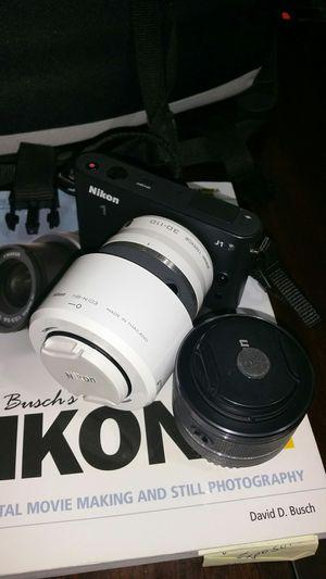 Nikon J1 camera/HD video metal body mirrorless for Sale in Orlando, FL