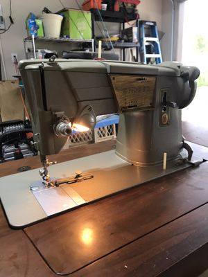 Vintage model singer 328 sewing machine in its on table for Sale in Mansfield, TX
