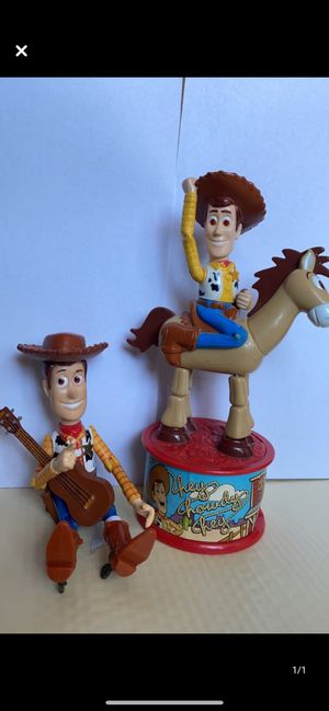 Vintage Toy Story collectibles. Woody with guitar and Woody on Bullseye. for Sale in El Paso, TX