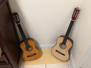 2 acustic guitar+ a free bag for Sale in Miami, FL