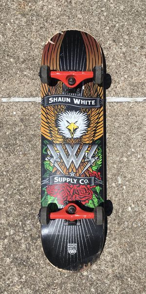 Shaun White vintage skateboard supply co. Metal trucks good shape skate board wheels for Sale in Brook Park, OH