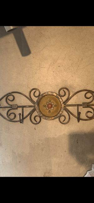 Wall decor, metal and has 4 hooks, unique and beautiful, hang hats or jewelry or kids sweaters or jackets etc for Sale in Mesa, AZ