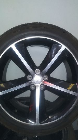 "22"" set of 4 rims and tires. 5 lug came off a chevy for Sale in Seattle, WA"