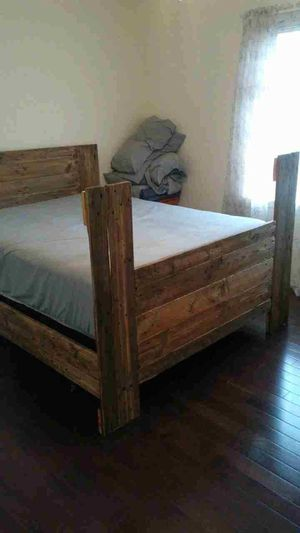 Queen Pallet Bed Frame - Handmade with metal rolling frame... Mattress not included for Sale in Commerce Charter Township, MI