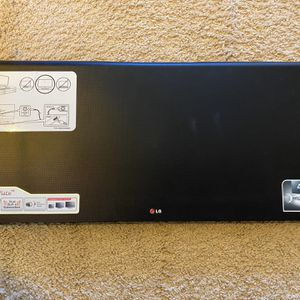 LG 4.1 Ch Sound bar with Subwoofer for Sale in Smithfield, VA