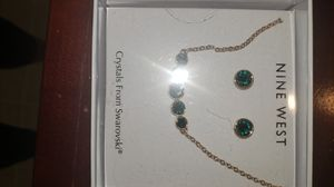 Swarovski green crystal earrings and necklace for Sale in Corona, CA
