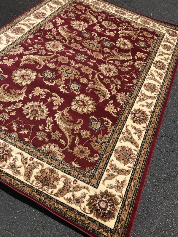 Brand new area rug size 5x8 nice red carpet