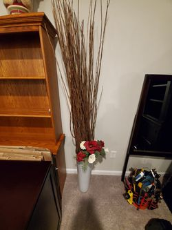 Vase with artificial flowers and sticks. for Sale in Sykesville,  MD