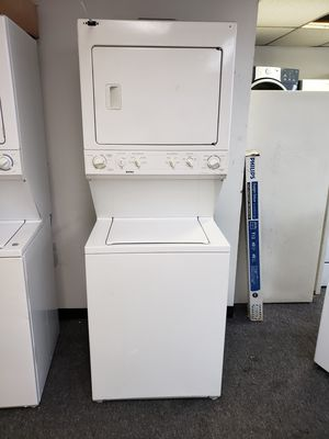27 INCHES LAUNDRY CENTER ELECTRIC GOOD CONDITION 90 DAYS OF WARANTY SE HABLA ESPAÑOL for Sale in Brooklyn, MD